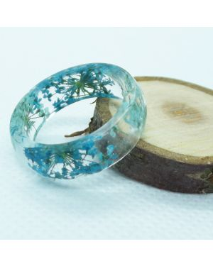 Real shades of teal flower resin ring