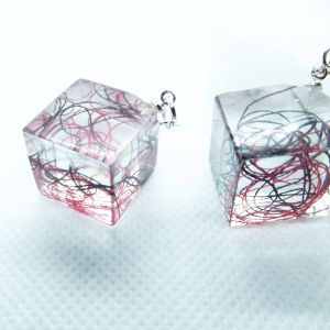 Black and Red yarn in a cube earrings
